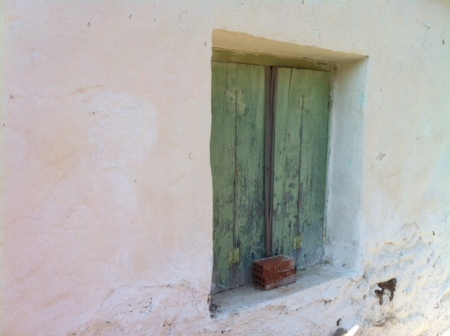 Typical whitewashed walls and painted shutters.  Looks nice but the reality is that it hides a difficult life.