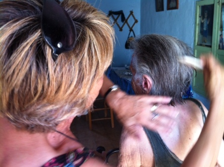 My Mum gently combing Yiayia Maria's hair after her bath.
