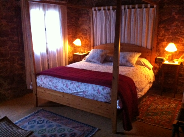 A bedroom at El Folló.  Cosy, rustic and very comfortable.