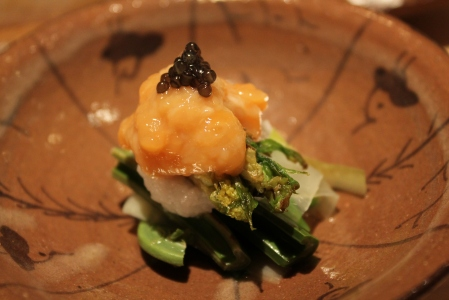 Fresh spring Japanese greens topped with sea cucumber roe.