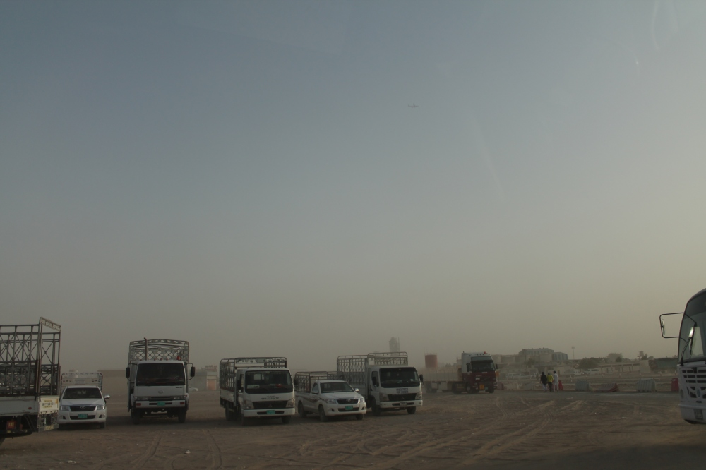 Arriving at Sajaa, an industrial area of Sharjah where many labourers and workers are stationed.  It's a dusty, desolate place with no streetlights and unpaved roads.  A glaring contrast to the city.