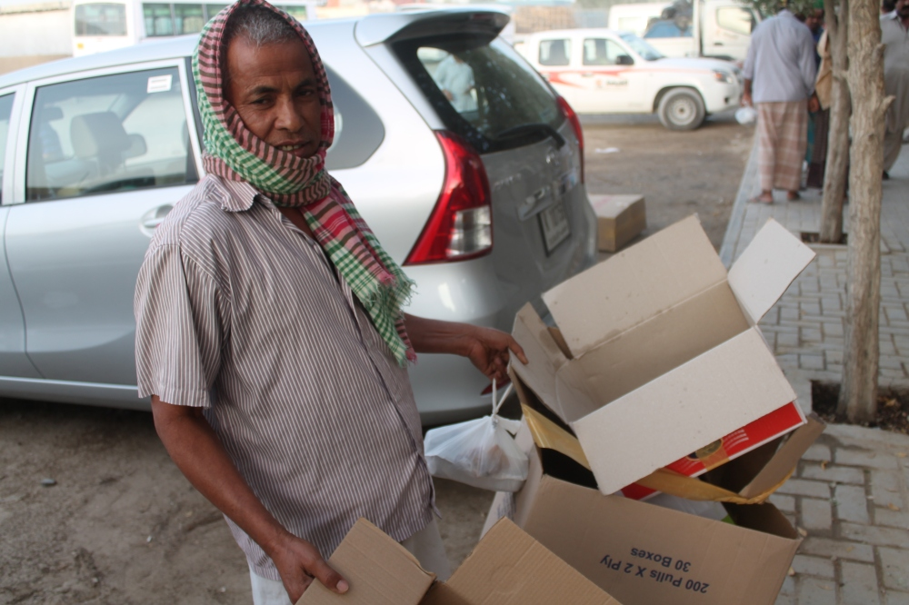 This guy will take the cardboard boxes that were used to transport some of the meals and recycle it, for pittance.  For some of the men, this is the only form of income they have here.
