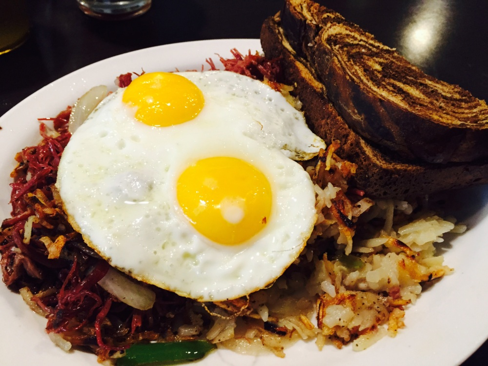 Beef hash and eggs, sunny side up